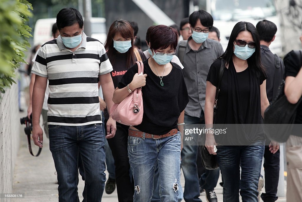 Relatives arrive at the Kwai Chung public mortuary to identify victims of a boat collision in Hong Kong on October 3, 2012, two days after a ferry collided with a pleasure boat killing at least 38 people a short distance from Lamma island. More than 120 passengers and crew were on the Hong Kong Electric company's Lamma IV to watch a huge National Day fireworks display in Victoria Harbour when the accident occurred just off Lamma, an island to the southwest of Hong Kong.