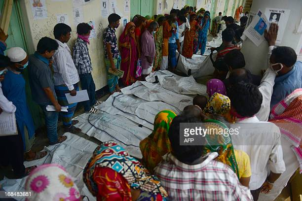 Relatives attempt to identify the bodies of loved ones killed in last week's building collapse in Savar on the outskirts of Dhaka on May 10 2013 The...