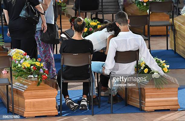Relatives attend a funeral mass for victims of the recent earthquake on August 27 2016 in Ascoli Piceno Italy Italy has declared a state of emergency...