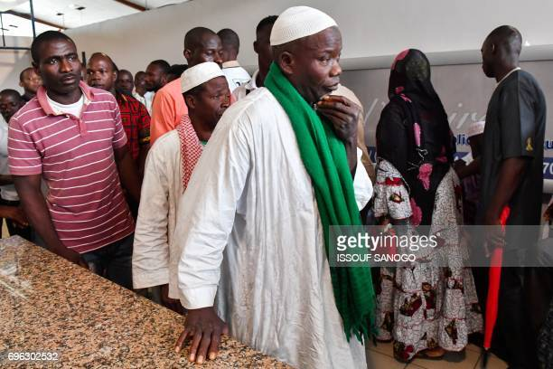 Relatives attend the arrival of the casket of the late Ivory Coast midfielder Cheick Tiote on June 15 2017 upon its arrival from China at Abidjan's...