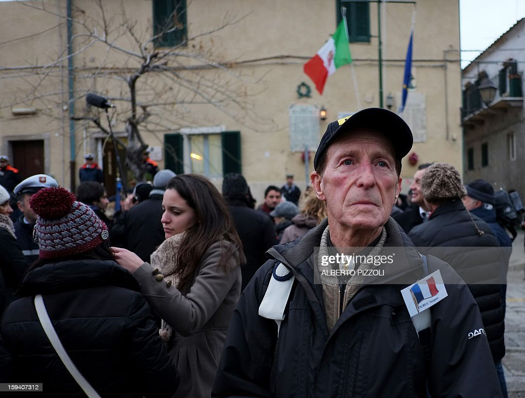Relatives attend the unveiling ceremony of a plaque with the names of the victims of the Costa Corncordia cruise ship in the port in the Italian island of Giglio on January 13, 2013. Survivors, grieving relatives and locals on the island of Giglio gathered on January 13 to mark the first anniversary of the Costa Concordia cruise ship disaster, which claimed 32 victims.