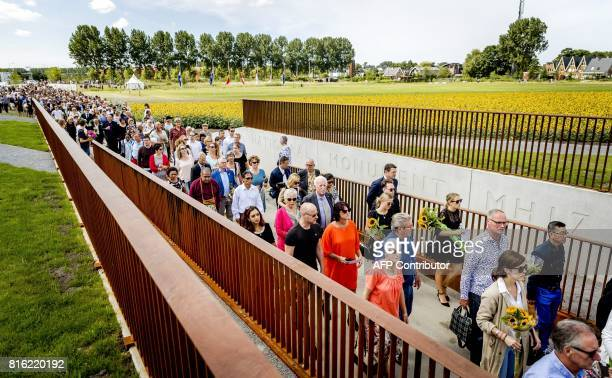 Relatives attend the unveiling of the National Monument for the MH17 victims in Vijfhuizen on July 17 2017 Three years after Flight MH17 was shot...