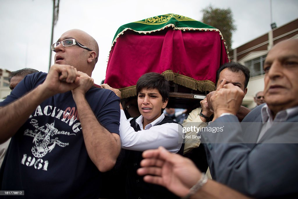 Relatives carry a coffin during a funeral procession for Selima Merali and her daughter Nuriana Merali who were killed in the attack by gunmen at the...