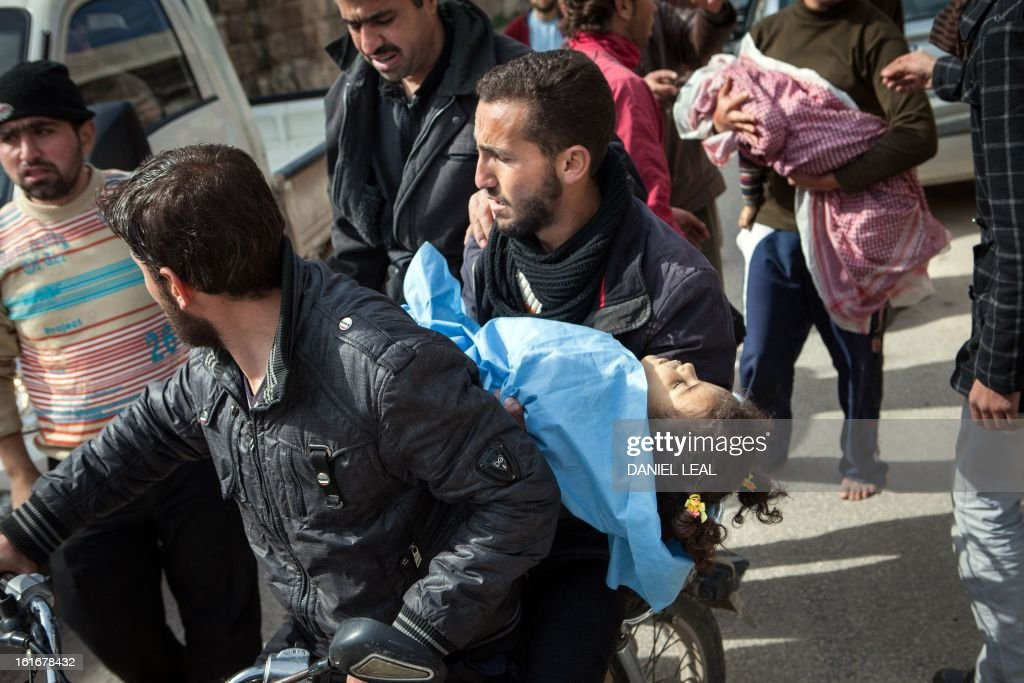 Relatives carry the bodies of 5-year old Elaf Daeef and her 2-year old brother Abdo Alhade Daeef, out of a hospital in Kfar Nubul after they were killed in an air strike on the town of Hass, in the northern Syrian province of Idlib, on February 14, 2013. A Syrian army jet fighter plane made an airstrike just after midday on the town of Hass killing at least 12 people, including four children.