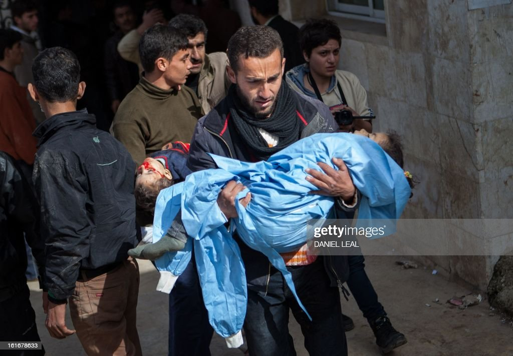 Relatives carry the bodies of 5-year old Elaf Daeef, and her 2-year old brother, Abdo Alhade Daeef, out of a hospital in Kfar Nubul after they were killed in an air strike on the town of Hass, in the northern Syrian province of Idlib, on February 14, 2013. A Syrian army jet fighter plane made an airstrike just after midday on the town of Hass killing at least 12 people, including four children.