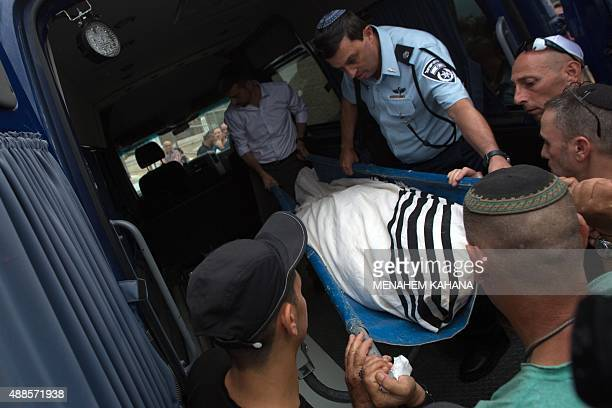 Relatives carry the body of 65yearold Jewish man Alexander Levlovitz who died of his injuries following a car crash in a Palestinian neighbourhood...