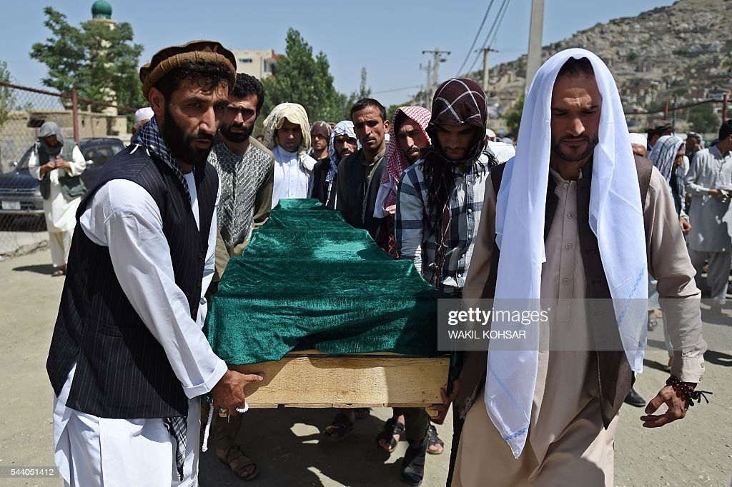 Relatives carry the coffin of Afghan police cadet Mohinddin ahead of his funeral prayers at The Qul Ab Chakan cemetery in Kabul on July 1, 2016, after his death in a Taliban attack in the Afghan capital. Mohinddin, who loved football and was passionate about joining the Afghan police force, was to return home after his graduation as a cadet to celebrate Eid al-Fitr with his family. He was one of 32 young cadets mown down by the Taliban one day before, killed in a suicide attack on the edge of the Afghan capital hours after their graduation. / AFP / WAKIL