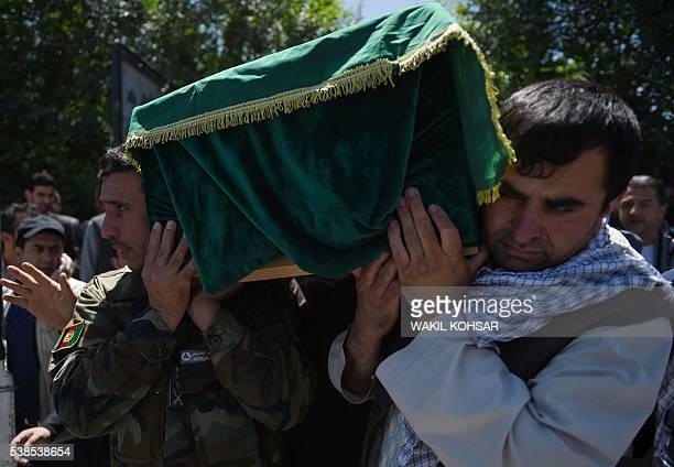 Relatives carry the coffin of Afghan reporter Zabihullah Tamanna ahead of his funeral prayers at a mosque in Kabul on June 7 2016 Zabihullah Tamanna...