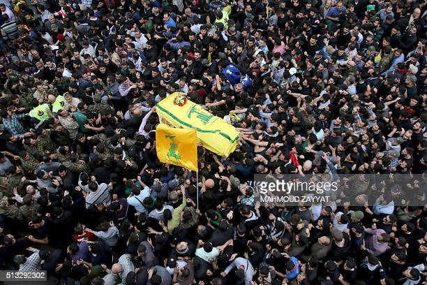 TOPSHOT Relatives carry the coffin of Ali Fayyad a fighter with Lebanon's Shiite movement Hezbollah who was killed while fighting alongside Syrian...