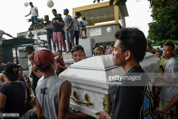 Relatives carry the coffin of Nino Maruso who was killed by police in what they say was a drug buybust operation during his funeral in Manila...