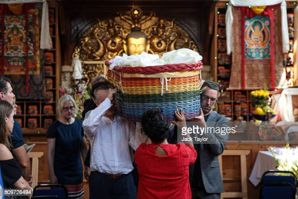 Relatives carry the willow eco coffin of Jon Underwood at the Jamyang Buddhist Centre on July 6 2017 in London England The funeral of Jon Underwood...