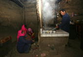Relatives cook food during a Tu ethnic minority group wedding ceremony of Qi Xinghe and his bride Luo Jinhua on January 30 2007 in Huzhu County of...