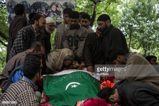 Relatives cry during the funeral of a teenager Adil Magray at Shopian about 60 kilometers south of Srinagar Indianadministered Kashmir Wednesday June...