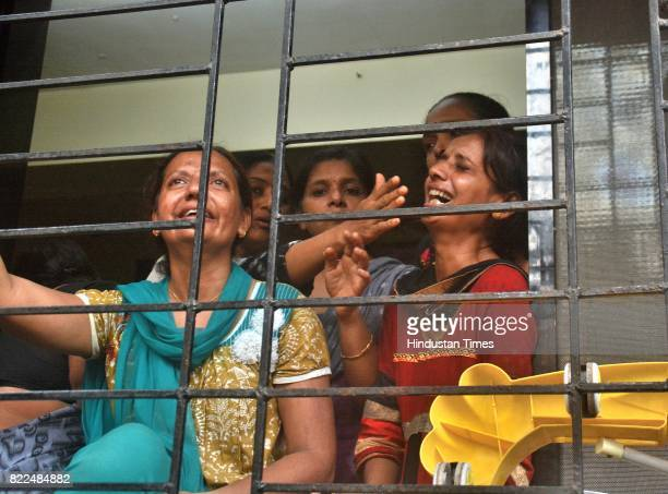 Relatives crying for their loved ones who lost their lives in building collapsed at Ghatkopar East on July 25 2017 in Mumbai India 12 people have...