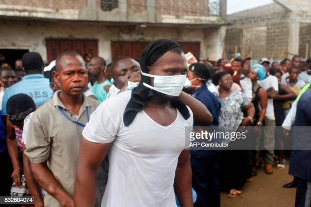 Relatives enquire on the fate of a victim at the Freetown Morgue Sierra Leone on August 16 2017 Sierra Leone began a weeklong period of national...