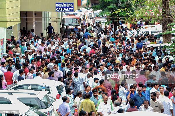 Relatives gather outside a hospital in Paravur following a huge fire at the Puttingal Devi Temple in the southern Indian state of Kerala on April 10...