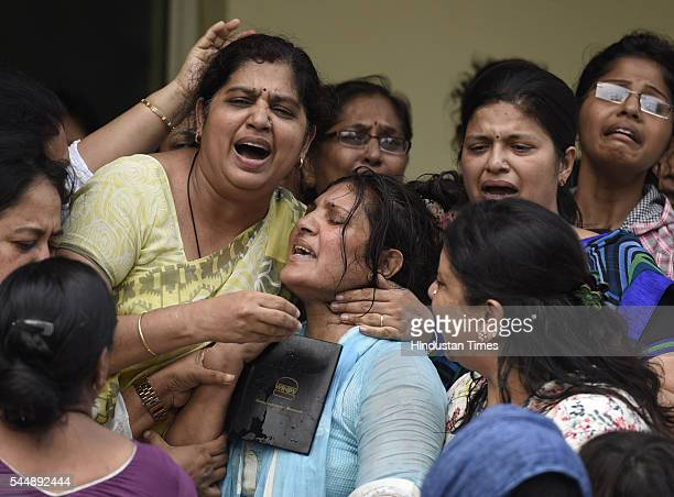 Relatives giving condolences to Tarishi's mother on July 4 2016 in Gurugram India 19yearold Tarishi Jain was killed along with 20 hostages in the...