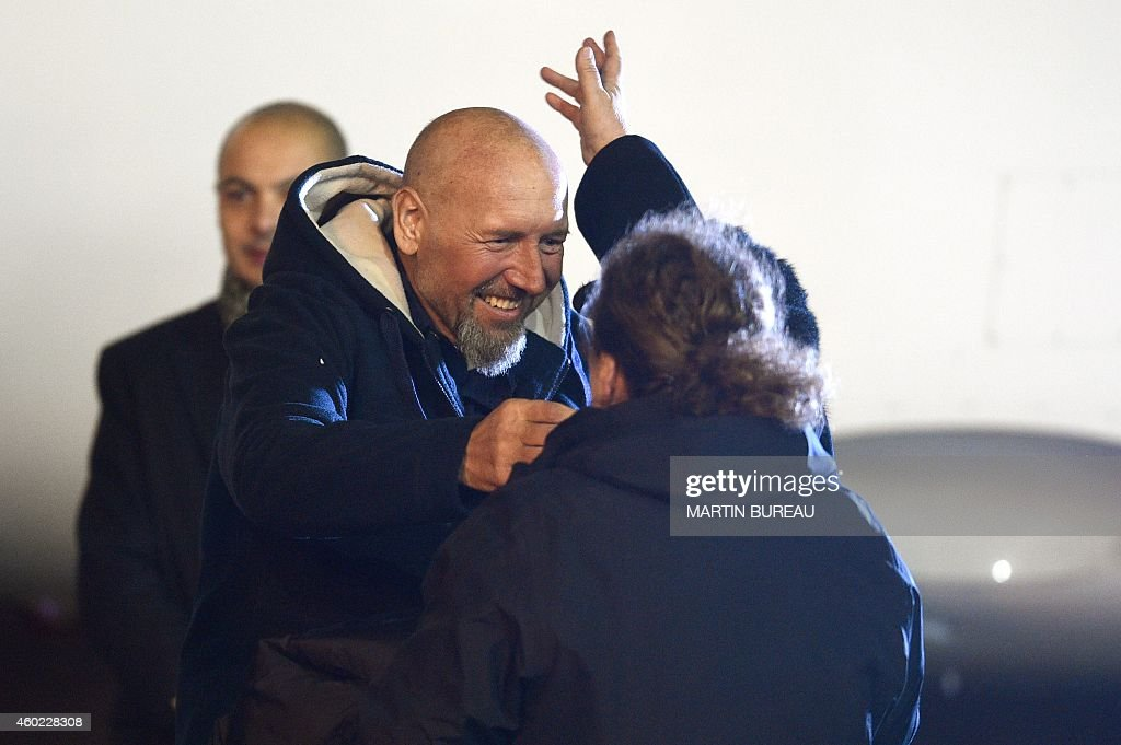 Relatives greet <a gi-track='captionPersonalityLinkClicked' href=/galleries/search?phrase=Serge+Lazarevic&family=editorial&specificpeople=9859570 ng-click='$event.stopPropagation()'>Serge Lazarevic</a> (L), France's last remaining hostage, after Lazarevic landed in a French Republic plane at the Villacoublay military base near Paris on December 10, 2014. Lazarevic, who was snatched by armed men in Mali on November 24, 2011, arrived home on December 10 after three years at the hands of Islamist militants, and was greeted by French President Francois Hollande. AFP PHOTO / MARTIN BUREAU