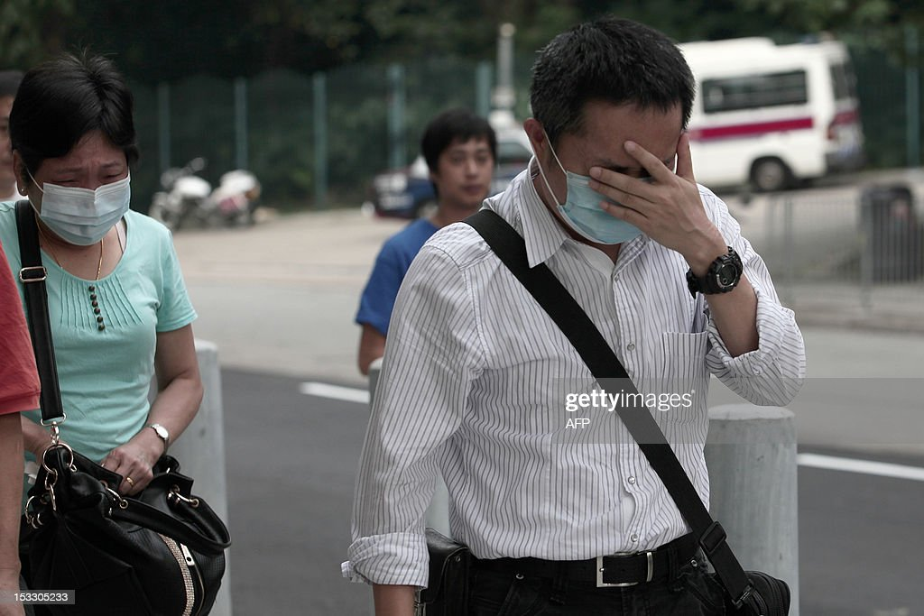 Relatives grieve as they arrive at the Kwai Chung public mortuary to identify victims of a boat collision in Hong Kong on October 3, 2012, two days after a ferry collided with a pleasure boat killing at least 38 people a short distance from Lamma island. More than 120 passengers and crew were on the Hong Kong Electric company's Lamma IV to watch a huge National Day fireworks display in Victoria Harbour when the accident occurred just off Lamma, an island to the southwest of Hong Kong.