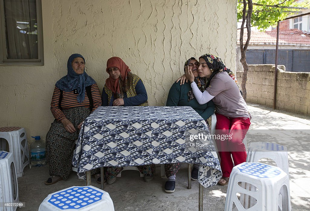 Relatives grieve for a mine worker who died in an explosion at Soma mine at their home in the village of Avdan on May 19 2014 near Soma Turkey Three...