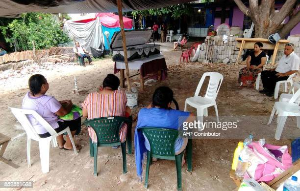 Relatives hold the wake for a victim of a 61magnitude earthquake in Ixtlatepec Oaxaca state Mexico on September 23 2017 Efforts to find life under...