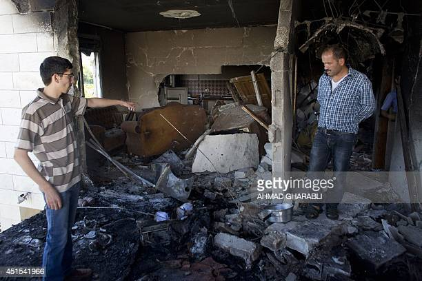 Relatives inspect the damage in the house of Marwan Qawasmeh a member of the Islamist Hamas in Hebron named by Israel as one of the two prime...