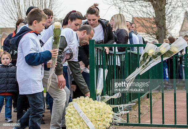 Relatives lay flowers on a playground in homage to a nineyearold girl who was killed a day before on April 16 2015 in Calais northern France A Polish...