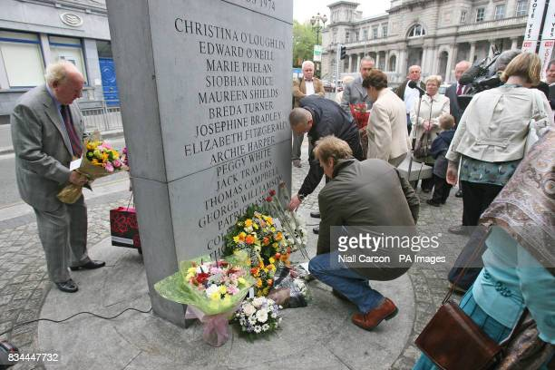 Relatives lay wreaths during the 34th annual commoration of the 1974 Dublin Monaghan Bombings in Dublin's Talbot Street