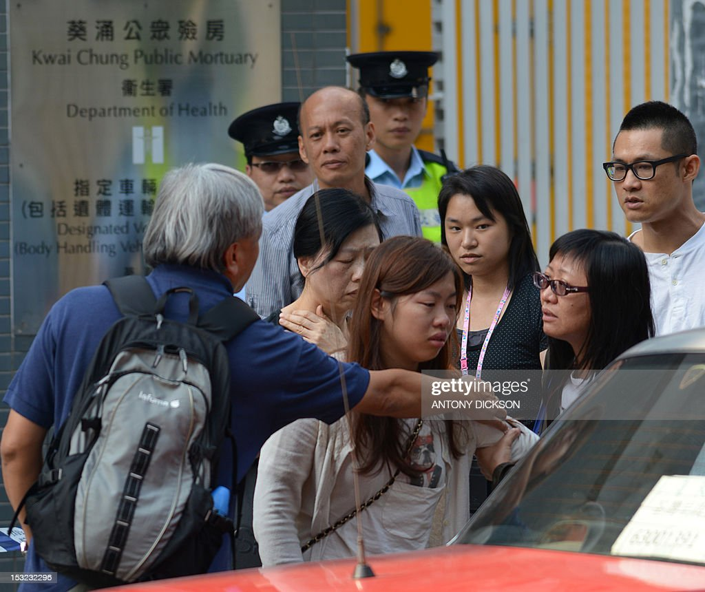 Relatives leave the Kwai Chung public mortuary after identifying a victim of a boat collision in Hong Kong on October 2, 2012. Thirty-six people were killed when a pleasure boat on a trip to watch holiday fireworks collided with a ferry and sank off Hong Kong, in the city's worst maritime accident in decades. More than 120 passengers and crew were on a Hong Kong Electric company vessel to watch the huge National Day fireworks display in Victoria Harbour on the evening of October 1 when the collision occurred near Lamma island. AFP PHOTO / Antony Dickson