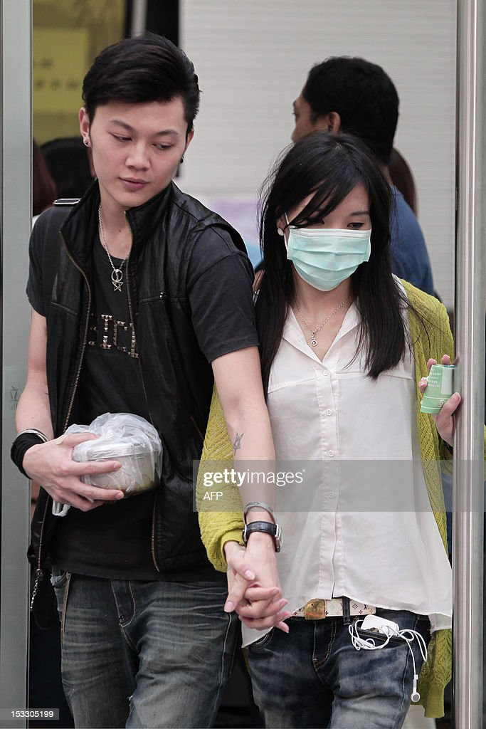Relatives leave the Kwai Chung public mortuary after identifying victims of a boat collision in Hong Kong on October 3, 2012, two days after a ferry collided with a pleasure boat killing at least 38 people a short distance from Lamma island. More than 120 passengers and crew were on the Hong Kong Electric company's Lamma IV to watch a huge National Day fireworks display in Victoria Harbour when the accident occurred just off Lamma, an island to the southwest of Hong Kong.