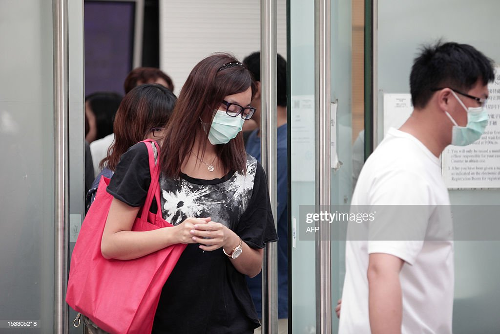 Relatives leave the Kwai Chung public mortuary after identifying victims of a boat collision in Hong Kong on October 3, 2012, two days after a ferry collided with a pleasure boat killing at least 38 people a short distance from Lamma island. More than 120 passengers and crew were on the Hong Kong Electric company's Lamma IV to watch a huge National Day fireworks display in Victoria Harbour when the accident occurred just off Lamma, an island to the southwest of Hong Kong. AFP PHOTO / ANTHONY WALLACE