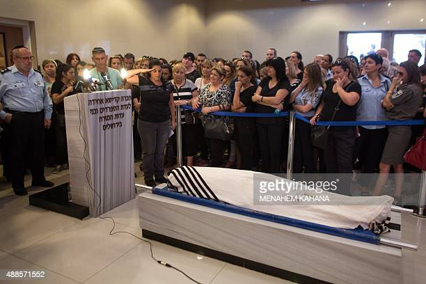 Relatives mourn at a Jerusalem cemetery on September 16 during the funeral of 65yearold Jewish man Alexander Levlovitz who died of his injuries...