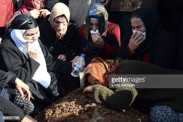 TOPSHOT Relatives mourn at the grave of 16yearold Mahmut Bulak who was killed during a protest against operations in Cizre on February 9 during his...
