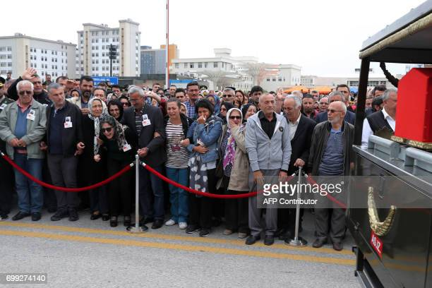 Relatives mourn by the coffin during the funeral ceremony of Turkish Captain Murat Ucoz who was killed during clashes with Kurdistan Workers' Party...