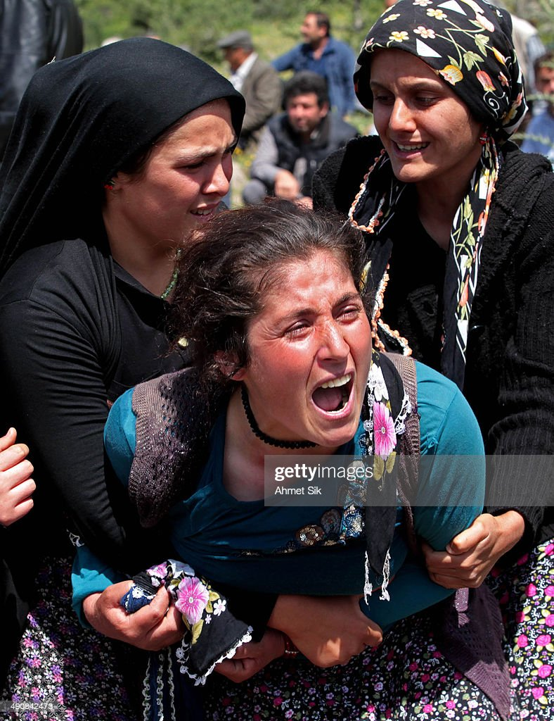 Relatives mourn during the funeral for the victims of a mining disaster on May 15 2014 in Soma a district in Turkey's western province of Manisa...