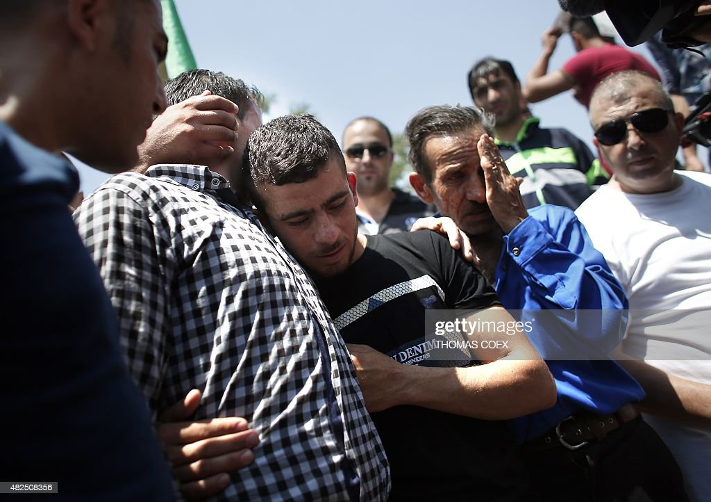 Relatives mourn during the funeral of 18monthold Palestinian toddler Ali Saad Dawabsha who died after his house was set on fire by Jewish settlers in...