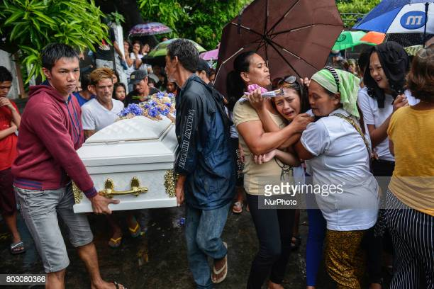 Relatives mourn during the funeral of Leah Espiritu who relatives say was a drug runner in Caloocan north of Manila Philippines June 11 2017 Leah...