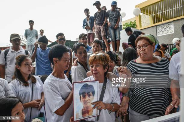 Relatives mourn during the funeral of Nino Maruso who was killed by police in what they say was a drug buybust operation in Manila Philippines July 9...