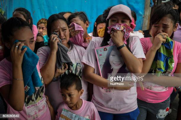 Relatives mourn during the funeral of sixteen year old Nercy Galicio who according to police was raped and killed by unknown men after going missing...