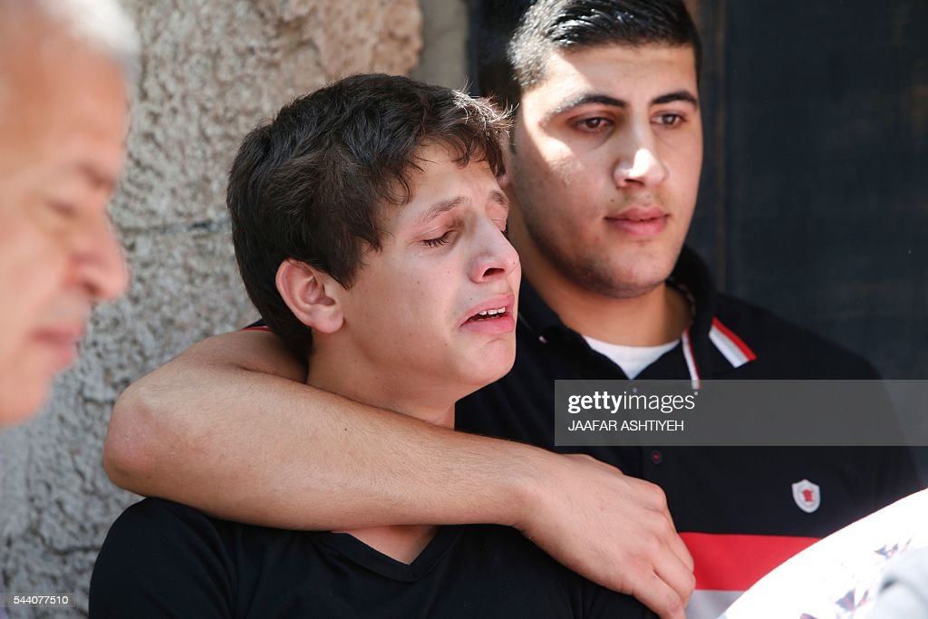 Relatives mourn during the funeral of Sondos al-Basha, a Palestinian woman who was killed in the Istanbul airport attack blamed on the Islamic State (IS) group on June 28, in the West Bank town of Qalqilyah on July 1, 2016. The suicide attackers who launched the deadly Istanbul airport assault were planning to take dozens of passengers hostage, Turkish media reported on July 1, 2016, as CCTV of the bombers' faces emerged. Turkish officials have pointed blame at the Islamic State jihadist group for the gun and bomb spree at Ataturk airport, which left at least 44 people dead including 19 foreigners. / AFP / JAAFAR
