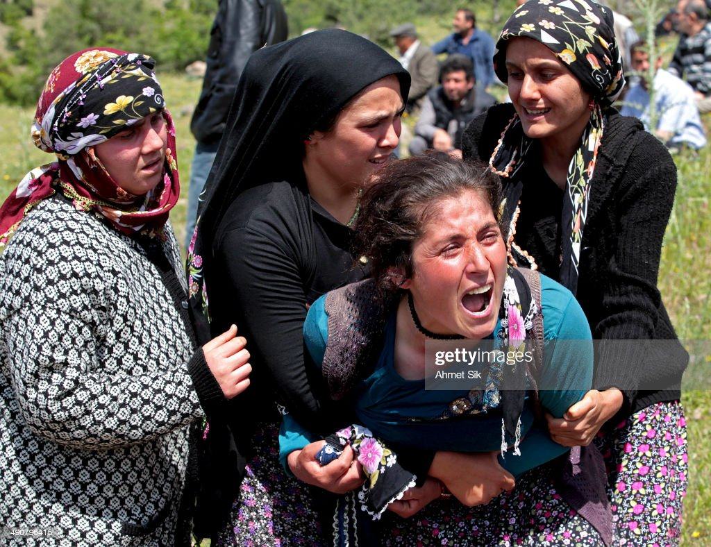 Relatives mourn during the funeral of the miners after a mining disaster on May 15 2014 in Soma a district in Turkey's western province of Manisa...