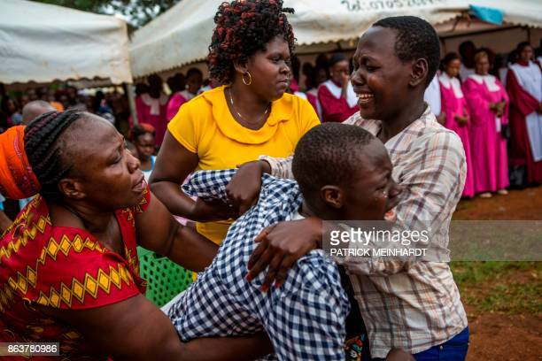 TOPSHOT Relatives mourn during the funeral service for three victims who were allegedly shot by police as they attended a demonstration last week in...
