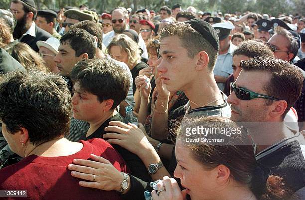 Relatives mourn for Israeli army reservist Vadim Nourezitz at his funeral service October 13 2000 in Or Akiva Israel 33yearold Nourezitz married a...