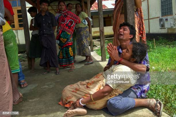Relatives mourn for members of their family whom they believe were killed by Rohingya militants at Maungdaw hospital on August 27 2017 The victims...