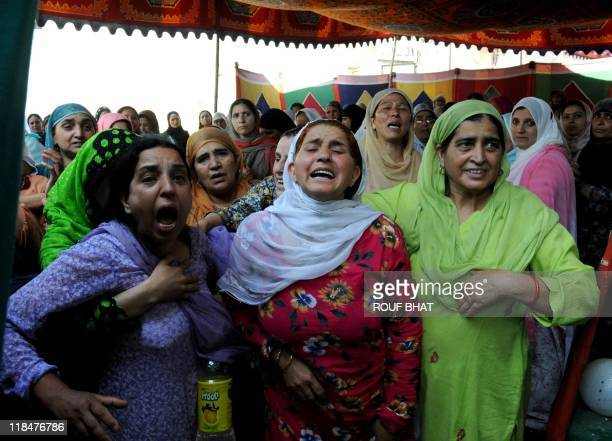 Relatives mourn near the body of a policeman during the funeral procession in Srinagar on July 6 2011 Shabir Ahmad an officer who was targeted in a...