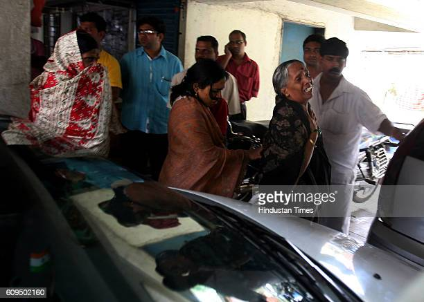 Relatives mourn outside the Kurnes Malad residence on Friday Abhijeet Kurne allegedly shot his wife Ashwini and himself with his fathers service...