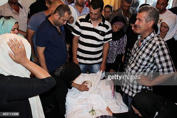 Relatives mourn over the body of Ibrahim Amory a member of the Lebanese army killed the previous day during clashes with militants in the city of...