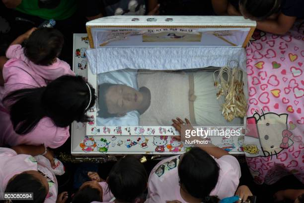Relatives mourn over the coffin of sixteen year old Nercy Galicio who according to police was raped and killed by unknown men after going missing for...