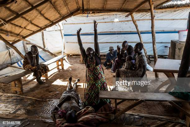TOPSHOT Relatives mourn the death of a family member due to the cholera crisis at the temporary hospital in Mingkaman a camp for the Internally...