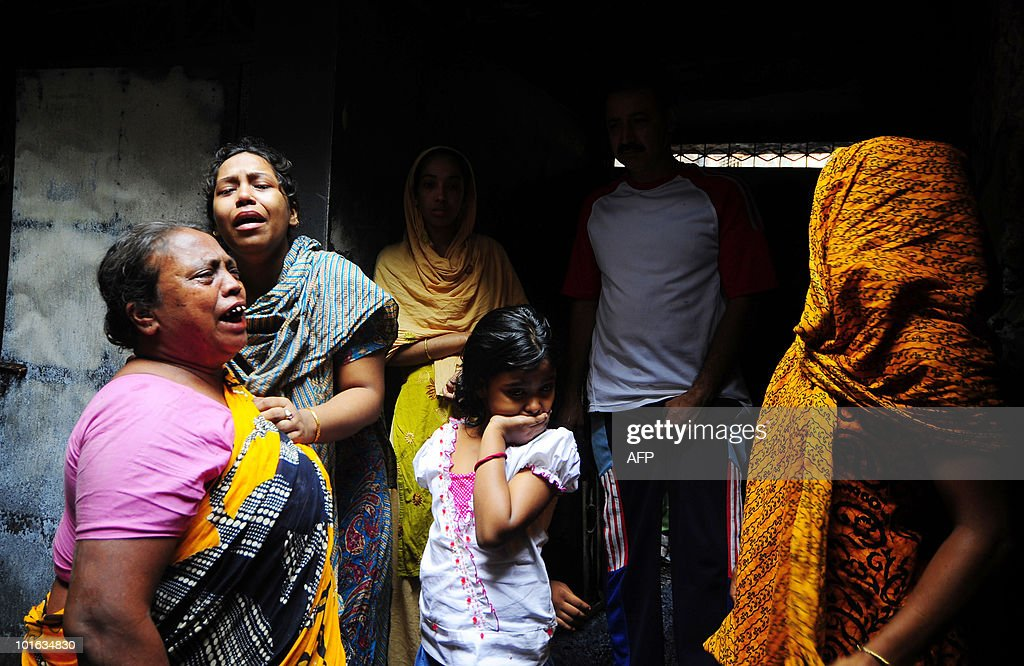 Relatives mourn the death of victims at the disaster site in Dhaka on June 5 , 2010. The national flag flew at half-mast and people of all faiths joined prayers as Bangladesh mourned the deaths of nearly 120 people in the country's deadliest blaze.